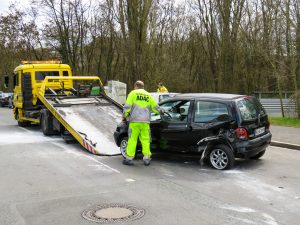 Yellow Flatbed Tow Truck Loading